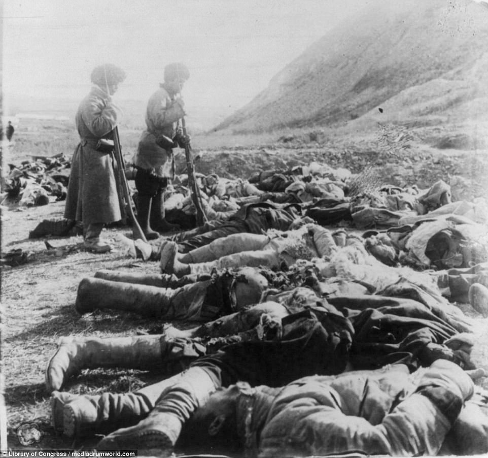 Russian soldiers gaze at heaps of their fallen comrades following the Battle of Port Arthur in February 1904. The battle marked the start of a war in which Russia would suffer massive losses, and began with a surprise night attack by a squadron of Japanese destroyers at the port in Manchuria